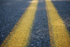 Middle lines of a road Royalty Free Stock Photo