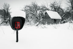 In The Middle Of Nowhere. Pay phone in a snow-covered field Stock Photos