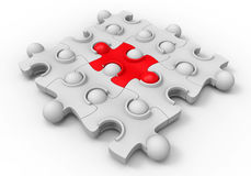Middle piece - jigsaw puzzle. 3D render illustration of jigsaw puzzle with 9 pieces and the middle part is colored in red indicating the middle one. The Royalty Free Stock Images