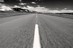 Middle of the Road. Black and white landscape view from the middle of the road in Montana Royalty Free Stock Images