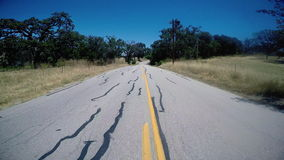 Middle of Road Driving POV. In the middle of the road driving POV stock footage