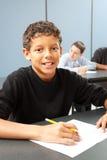 Middle School Boy in Class. Handsome ethnic boy in school class. Real person in real classroom stock photos