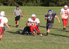 Middle school football runner Stock Photography