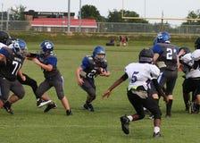 Middle school football runner Stock Image