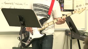 Middle school students practicing in Music Class (1 of 10). A view or scene of School stock footage
