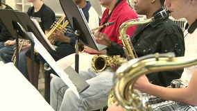 Middle school students practicing in Music Class (10 of 10). A view or scene of School stock video