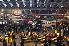 The middle section of the Foodfestival. Amsterdam, the Netherlands - November 29, 2015: The Fruitland, Pachamama, Petit Amsterdam and Cart Blanche trucks in the Stock Photography