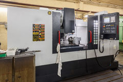 Middle size CNC milling machine. Outside view of workplace Stock Photo