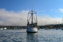 Middle sized boat in the bay, front view royalty free stock photos