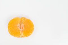 In the middle. Some slices of clementine on a white background Stock Image