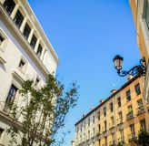 Mixture of old and colorful buildings in downtown Madrid. In the middle of the warm summer, the yellow tones gives this place a vibrant atmosphere royalty free stock photo