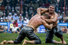 Middle weight wrestlers struggle for victory at the Kemer Turkish Oil Wrestling Festival in Kemer, Turkey. Kemer is a seaside district of Antalya Province on Royalty Free Stock Photo