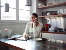 Middle woman in modern kitchen Royalty Free Stock Photography