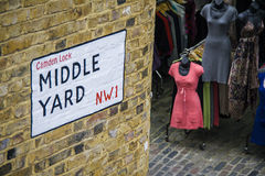 Middle Yard Street sign on a bricked wall in Camden lock market London, UK. Middle Yard Street sign on a bricked wall in Camden lock market. Famous alternative Royalty Free Stock Photos