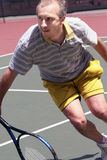 Middleage man playing tennis Royalty Free Stock Photography