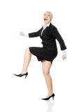 Middleaged businesswoman running Stock Image