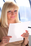 Middleaged businesswoman with sheet of paper Royalty Free Stock Photos