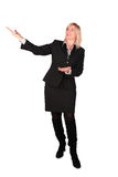 Middleaged businesswoman shows... Royalty Free Stock Image