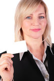 Middleaged businesswoman shows white card Royalty Free Stock Images