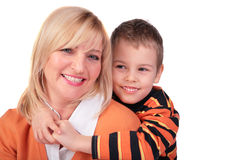 Middleaged woman with boy posing Royalty Free Stock Image