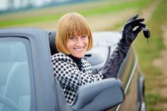 Middleaged woman with her new car Stock Photography