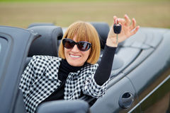 Middleaged woman with her new Convertible Stock Photo