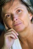 Middleaged woman looking ahead Stock Photo