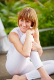 Middleaged woman make a break of the workout Stock Image