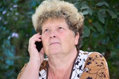 Middleaged woman talks on  mobile phone Stock Image