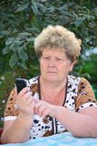 Middleaged woman talks on  mobile phone Stock Photos