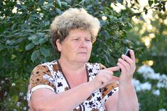 Middleaged woman talks on  mobile phone Royalty Free Stock Photo