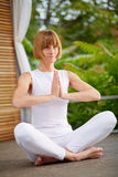 Middleaged woman at Yoga Royalty Free Stock Images