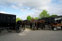 MIDDLEBURY, INDIANA, UNITED STATES - MAY 22nd, 2018: View of amish carriage along the city, known for simple living with. Touch of nature contacy, plain dress royalty free stock photography
