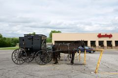 MIDDLEBURY, INDIANA, UNITED STATES - MAY 22nd, 2018: View of amish carriage along the city, known for simple living with. Touch of nature contacy, plain dress stock photos
