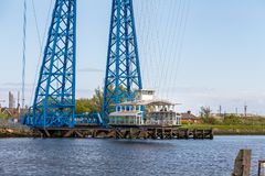 Transporter Bridge, Middlesbrough, UK. Middlesbrough, England, UK - May 14, 2016: View towards the transporter bridge with a gondola passing the River Tees Royalty Free Stock Image