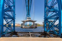 Transporter Bridge, Middlesbrough, UK. Middlesbrough, England, UK - May 14, 2016: View towards the transporter bridge with a gondola passing the River Tees Stock Photography