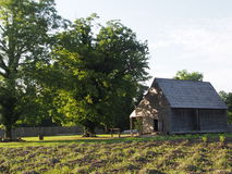 A Middling Plantation. The tobacco barn sits alongside the field of a colonial American middling plantation in Tidewater Virginia Stock Images