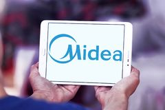 Midea Group logo. Logo of Midea Group on samsung tablet. Midea Group is a Chinese electrical appliance manufacturer, headquartered in Beijiao, Shunde, Foshan royalty free stock image