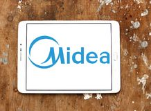 Midea Group logo. Logo of Midea Group on samsung tablet. Midea Group is a Chinese electrical appliance manufacturer, headquartered in Beijiao, Shunde, Foshan stock photography