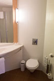 Midern hotel toilet. Modern bathroom with toilet sink. Royalty Free Stock Images