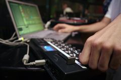 Midi Controller - DJ 5. DJ performance with midi controller and laptop Stock Images