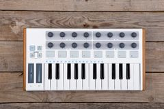 Close up of MIDI controller volume fader, knob and keys. MIDI controller volume fader, knob and keys Stock Images
