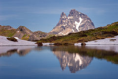 The Midi d`Ossau peak reflected in a lake in the Pyrenees Nation Royalty Free Stock Photo