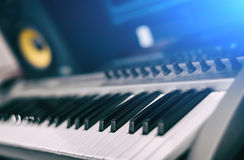 Midi keyboard. Home recording studio with professional monitors Stock Images