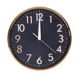 Midi sur le cadran de l'horloge ronde Photographie stock