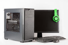 Midi tower computer case with led monitor on white background. Stock Photos