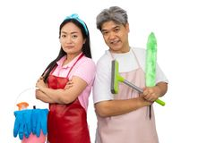 Midle-aged ,young asian couple holding cleaning supplies while standing in studio, isolated on white background,include clipping royalty free stock photos