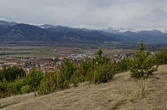 Midmost part of the Zlatitsa Pirdop valley and residential district of  village Chavdar in background of the snowy Balkan mountain. Sofia, Bulgaria, Europe royalty free stock photo