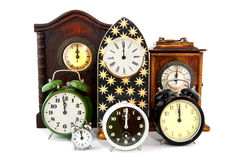 Midnight. Twelve O'Clock with many clocks at new years eve Stock Images