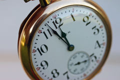 Almost Midnight. Pocket watch with time at almost midnight Royalty Free Stock Photo
